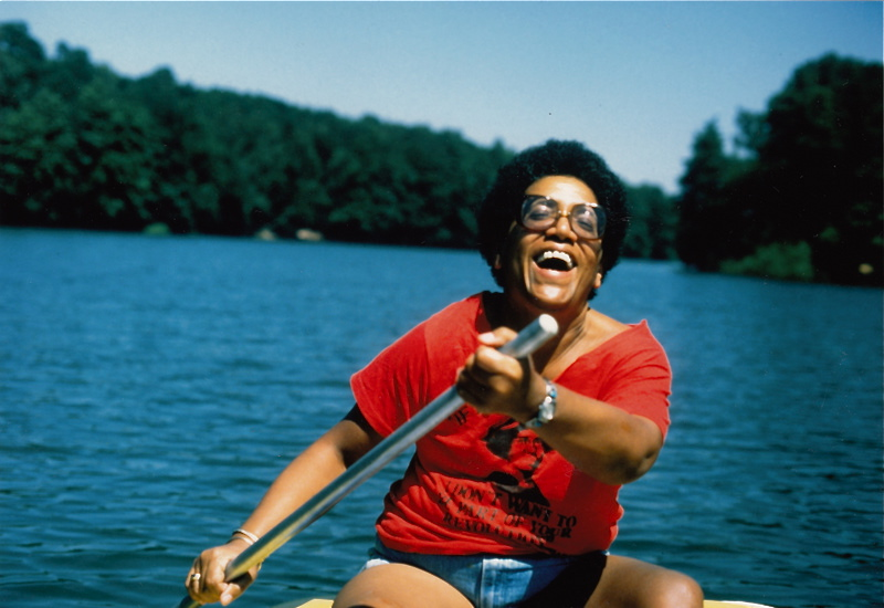 image of Audre Lorde with a joyous smile while canoeing on a lake